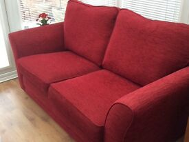 Large 2 seater sofa bed excellent condition, couple years old, lovely red colour