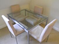 Bespoke stylish glass dining table with 4 suede chairs