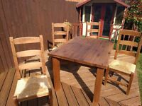Rustic Solid Oak Table with 4 Chairs. Slightly marked top, through general wear and tear.