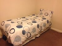 Give away asap one single bed with mattress and store.