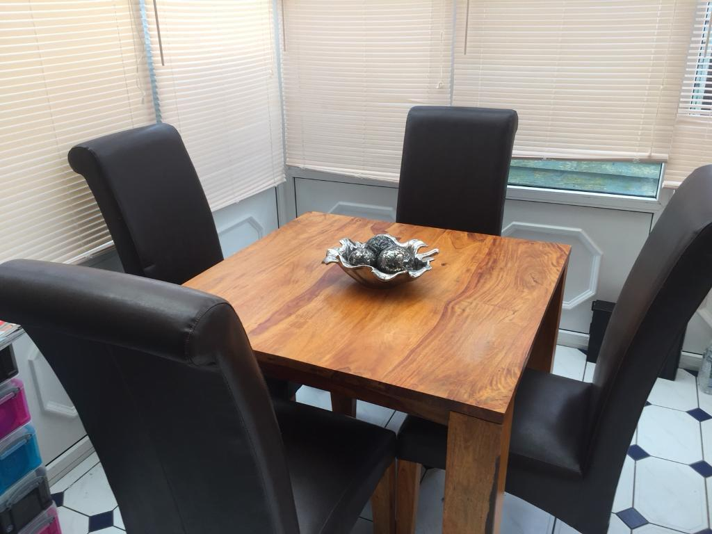Dining table and 4 dark brown chairs