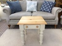 Solid pine coffee table with drawer, stripped top, remainder painted cream