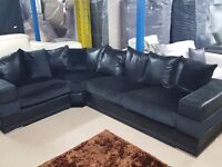 Fantastic BRAND NEW large black fabric corner sofa.Lovely wide arms.can deliver