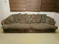 brown fabric 4 seater sofa