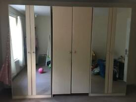 3 high ceiling wardrobes