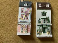 Ceramic wall mounted houses.
