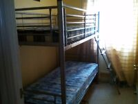 Metal bunk beds for sale with 2 mattresses and duvets and covers if required