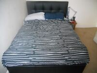 double bed with faux leather headboard & storage