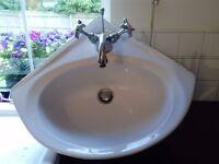 Corner sink with mixer taps