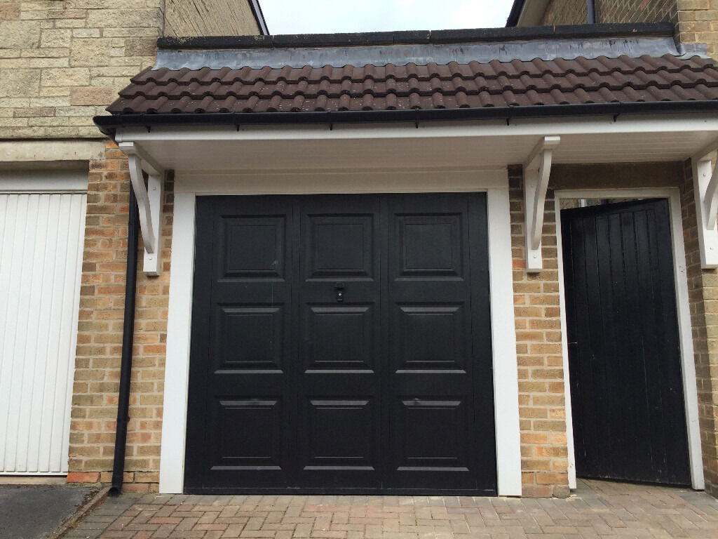 Reduced for quick sale black steel georgian style single garage black steel georgian style single garage door with original lock and rubansaba