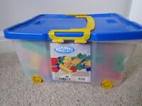Mochtoys Childrens bricks in a box on wheels (about 150pcs)