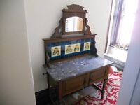 A fabulous authentic marble topped washstand cabinet with mirror, tiled back and storage cupboard