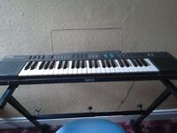 Electric Yamaha keyboard with stand and chair