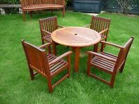 Children's hardwood garden table and four chairs.