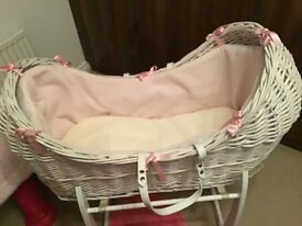 White and pink Clare De Lune baby crib with matching white stand