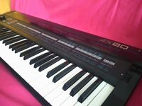 Akai AX80 - rare 8 voice polyphonic analogue synthesizer with midi like roland juno