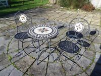 Mosaic Tile Top Round Metal Table and two matching folding metal chairs