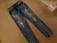 Ladies slim fit ripped jeans.