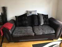 DFS sofa 4 seater in gray/black very good condition! I am only selling due to relocation!