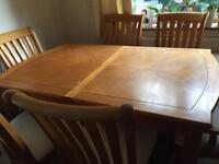 Solid extendable pine dining table & 6 cushioned chairs