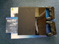 Sony Playstation4 (Boxed) with Two Controllers, Call of Duty Game and Cables