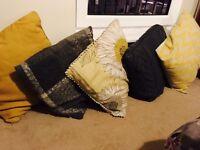 Mixed grey and yellow cushions