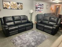 Beautiful ex display black electric recliner 3&2 seater real leather sofa