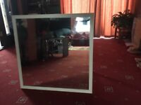 Large mirror with white surround