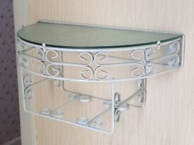 Decorative wall shelf with glass inset