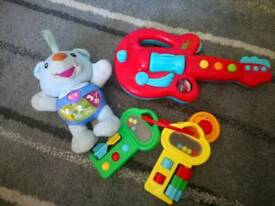 Childrens toys, working with batteries, musical bear, guitar and keys