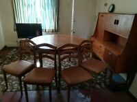Teak circular dining table and 4 chairs - retro from 1970's.