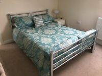 Chrome double bed and Laura Ashley bed set