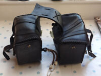 Black leather adjustable panniers