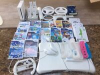 Wii fit & Accessories & games as per photo