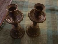 One pair of heavy brass ringing bell candle sticks