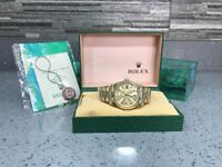 Rolex day date gold automatic sweeping movement brand new