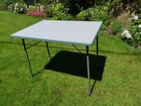 Fold-flat camping table
