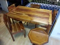 Lovely solid wood dining table and 4 chairs. excellent condition.