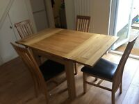 Solid Oak extendable table & 4 chairs