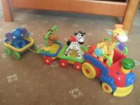 Fisher Price Amazing Animals Sing and Go Choo Choo