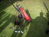 Set of junior golf clubs with bag, trolley, tees and balls