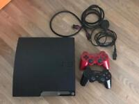 PS3 console, with two controllers and 33 games