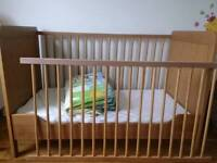 Cot bed with very good mattress and bedding as extras