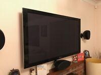 "Pioneer 50"" Plasma TV and Denon Surround Receiver."