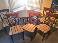 Vintage dining table (mind blowing fold-away feature) and 6 chairs. Great condition!