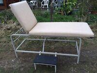 Metal massage table