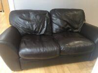 Sofa: Two seater brown leather sofa