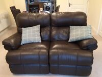 Two seater brown leather reclining sofa