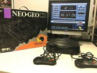 NEO GEO CD CONSOLE. BOXED WITH 9 GAMES!!!! AND EXTRAS. MUST SEE!!!!