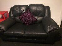2x 2 seater black leather sofas